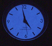 Atomic Analog watch dial in the dark.